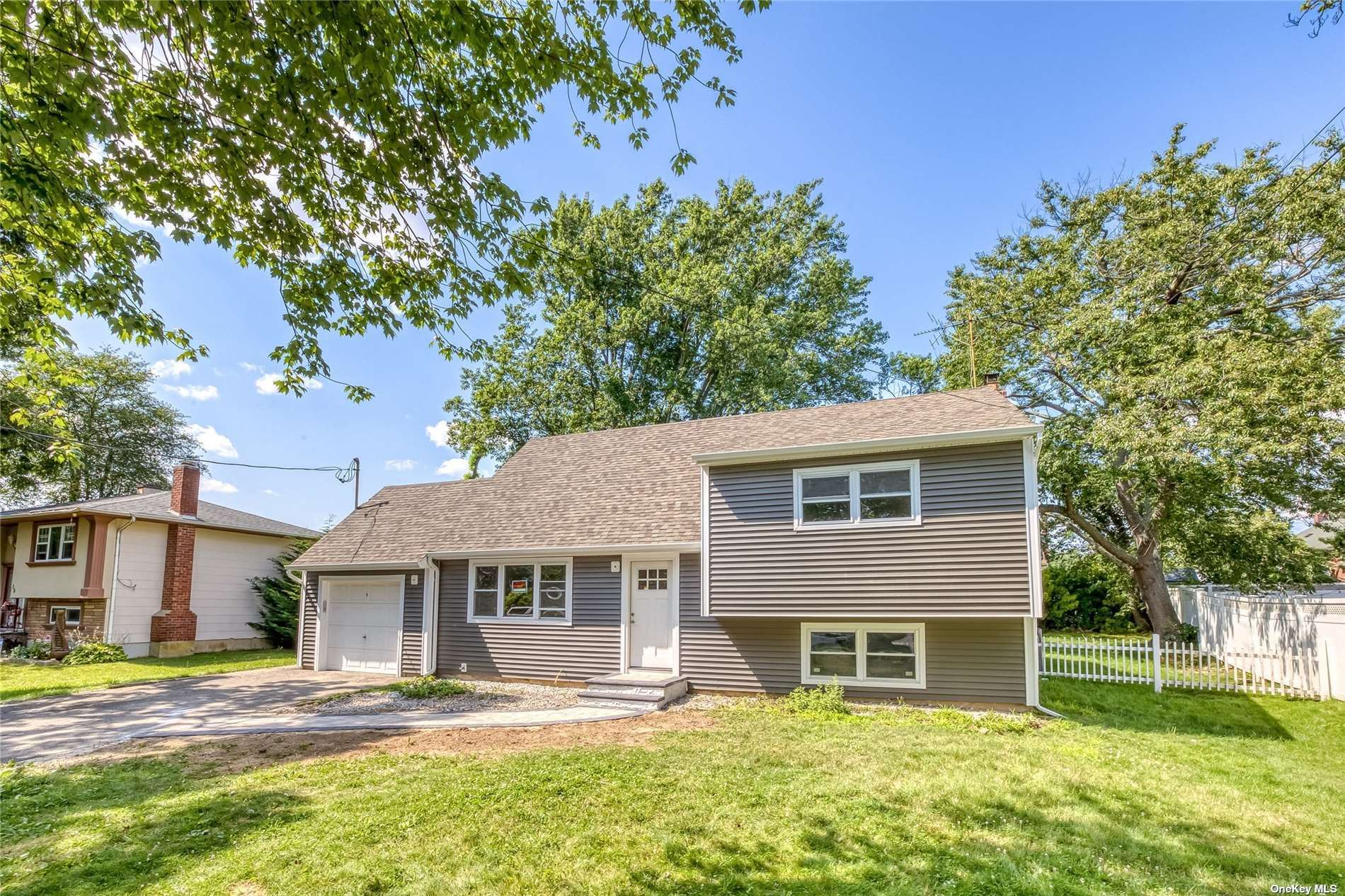 Photo of 23 Elwin Place, Copiague, NY 11726 (MLS # 3333481)