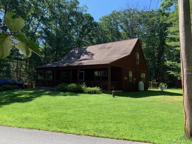 Photo of 36 Wolf Pond Road, Wurtsboro, NY 12790 (MLS # H6019559)