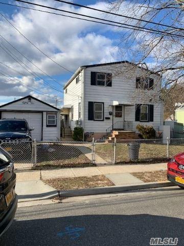 Photo of 82 Emporia Ave, Elmont, NY 11003 (MLS # 3194944)