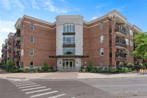 Photo of 111 N WHEATON Avenue #310, Wheaton, IL 60187 (MLS # 11127338)