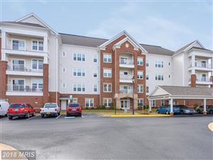 Photo of 20650 HOPE SPRING TER #103, ASHBURN, VA 20147 (MLS # LO10158138)