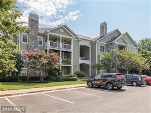 Photo of 1716 LAKE SHORE CREST DR #4, RESTON, VA 20190 (MLS # FX10272283)
