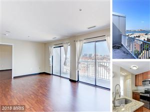 Photo of 2702 LIGHTHOUSE POINT E #718, BALTIMORE, MD 21224 (MLS # BA10320336)