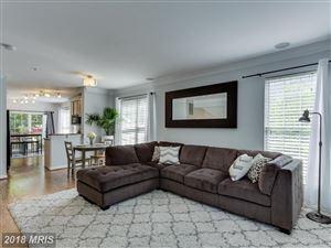 Photo of 8850 ASHGROVE HOUSE LN #102, VIENNA, VA 22182 (MLS # FX10252411)
