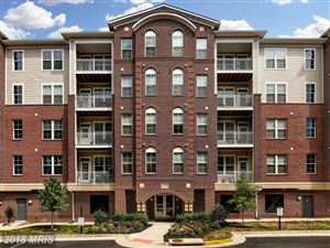 Photo of 13724 NEIL ARMSTRONG AVE #209, HERNDON, VA 20171 (MLS # FX10322494)