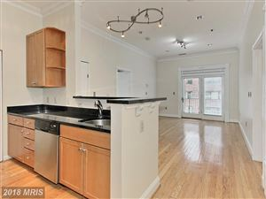 Photo of 309 HOLLAND LN #220, ALEXANDRIA, VA 22314 (MLS # AX10160812)
