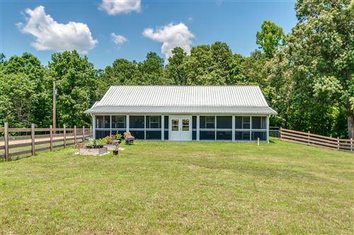 Photo of 1482 Little Swan Crk Rd, Hohenwald, TN 38462 (MLS # 2295434)
