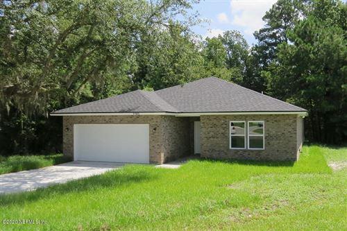 Photo of 11993 SMITH POINTE CT, JACKSONVILLE, FL 32218 (MLS # 1055075)