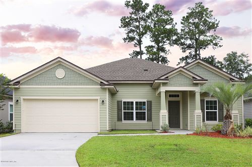 Photo of 5049 REDFORD MANOR DR, JACKSONVILLE, FL 32258 (MLS # 1077095)