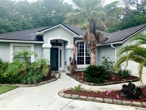 Photo of 2104 GROTTO CT, MIDDLEBURG, FL 32068 (MLS # 1055100)