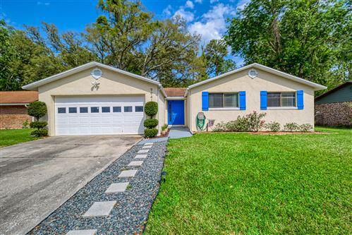 Photo of 9941 TIMBERLAKE DR E, JACKSONVILLE, FL 32257 (MLS # 1047143)