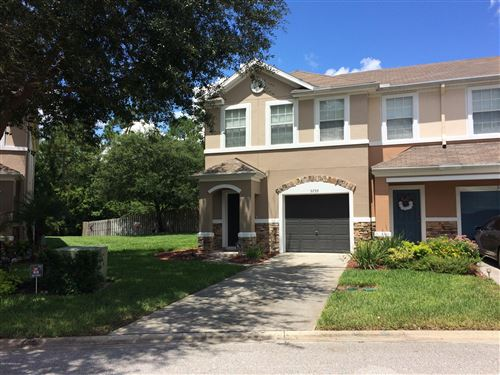 Photo of 5759 PARKSTONE CROSSING DR, JACKSONVILLE, FL 32258 (MLS # 1066264)
