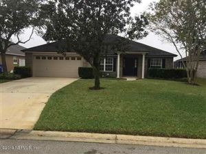 Photo of 766 E RED HOUSE BRANCH RD, ST AUGUSTINE, FL 32084 (MLS # 1025303)