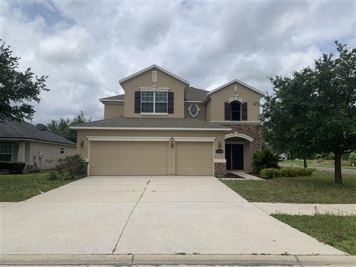 Photo of 13830 DEVAN LEE DR N, JACKSONVILLE, FL 32226 (MLS # 1040324)
