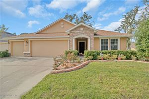 Photo of 12332 ACOSTA OAKS DR, JACKSONVILLE, FL 32258 (MLS # 969343)