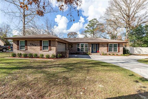 Photo of 8825 COUNTRY WOODS CT, JACKSONVILLE, FL 32222 (MLS # 1033358)