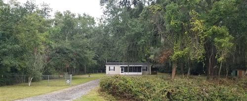Photo of 6259 TROUT RIVER BLVD, JACKSONVILLE, FL 32219 (MLS # 1023421)
