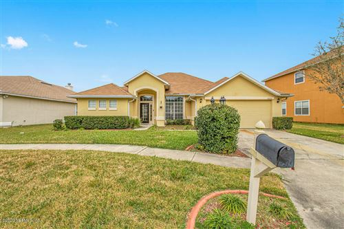 Photo of 10277 MEADOW POINT DR, JACKSONVILLE, FL 32221 (MLS # 1036456)