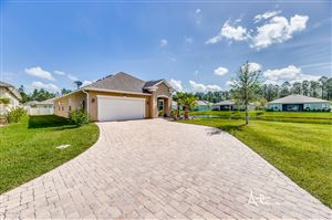 Photo of 10105 BEDFORD LAKES CT, JACKSONVILLE, FL 32222 (MLS # 995473)