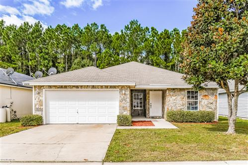 Photo of 96587 COMMODORE POINT DR, YULEE, FL 32097 (MLS # 1020524)