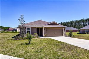Photo of 78153 SADDLE ROCK RD, YULEE, FL 32097 (MLS # 991560)
