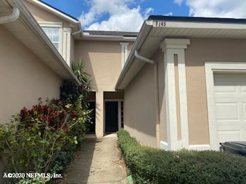 Photo of 7845 PLAYPEN CT, JACKSONVILLE, FL 32210 (MLS # 1042597)