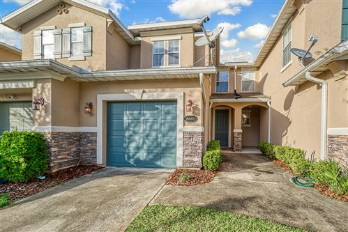 Photo of 8881 GRASSY BLUFF DR, JACKSONVILLE, FL 32216 (MLS # 1033624)