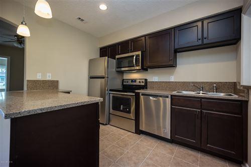 Photo of 4665 TIMUQUANA RD, JACKSONVILLE, FL 32210 (MLS # 1038630)