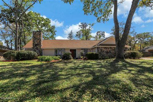 Photo of 11569 BASKERVILLE RD, JACKSONVILLE, FL 32223 (MLS # 1043651)