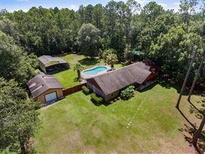 Photo of 1249 SURREY GLEN RD, MIDDLEBURG, FL 32068 (MLS # 941712)
