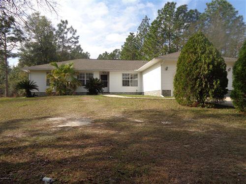 Photo of 207 PICNIC RD, INTERLACHEN, FL 32148 (MLS # 1034762)
