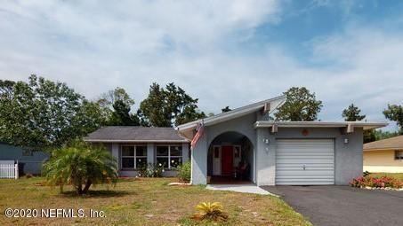 Photo of 5 FARMBROOK LN, PALM COAST, FL 32137 (MLS # 1036782)