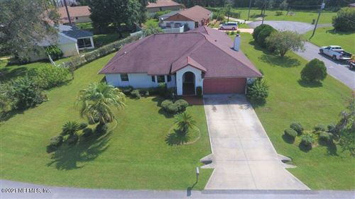 Photo of 81 WELLSHIRE LN, PALM COAST, FL 32164 (MLS # 1129796)