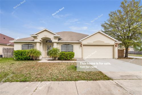 Photo of 10197 MEADOW POINT DR, JACKSONVILLE, FL 32221 (MLS # 1042890)