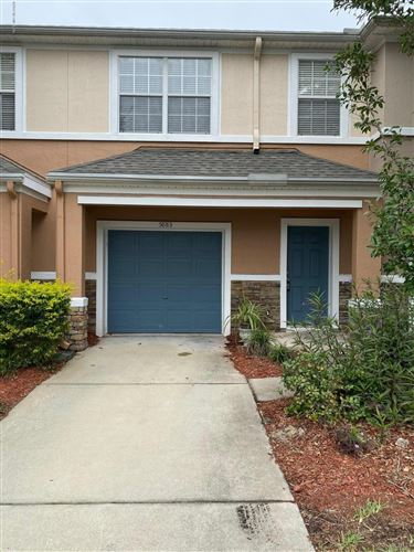 Photo of 5883 PARKSTONE CROSSING DR, JACKSONVILLE, FL 32258 (MLS # 1025982)