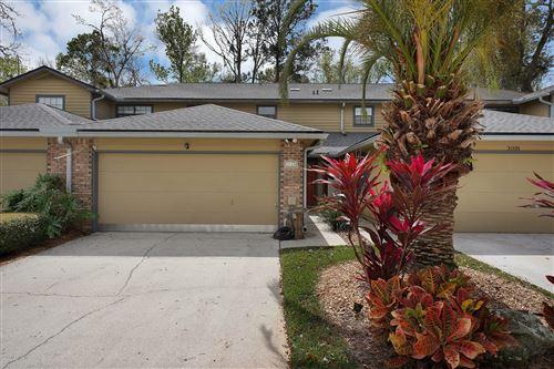 Photo of 3110 PADDLE CREEK DR, JACKSONVILLE, FL 32223 (MLS # 1040987)