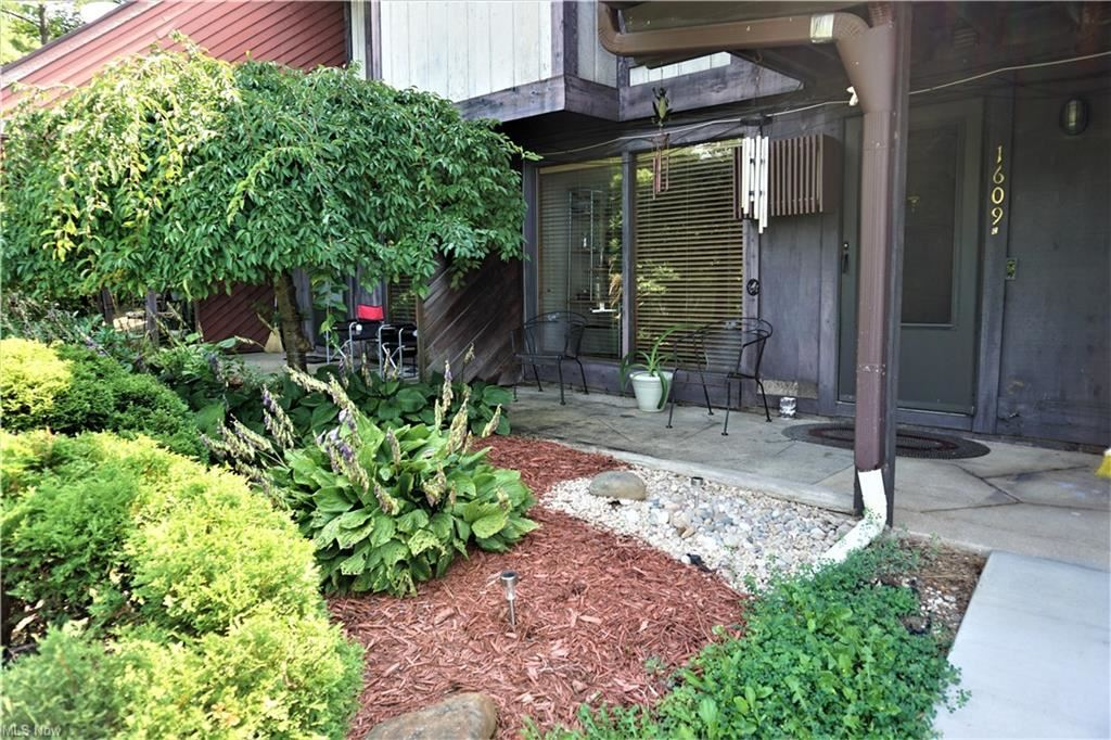 Photo of 1609 Treetop Trail #C, Akron, OH 44313 (MLS # 4303203)
