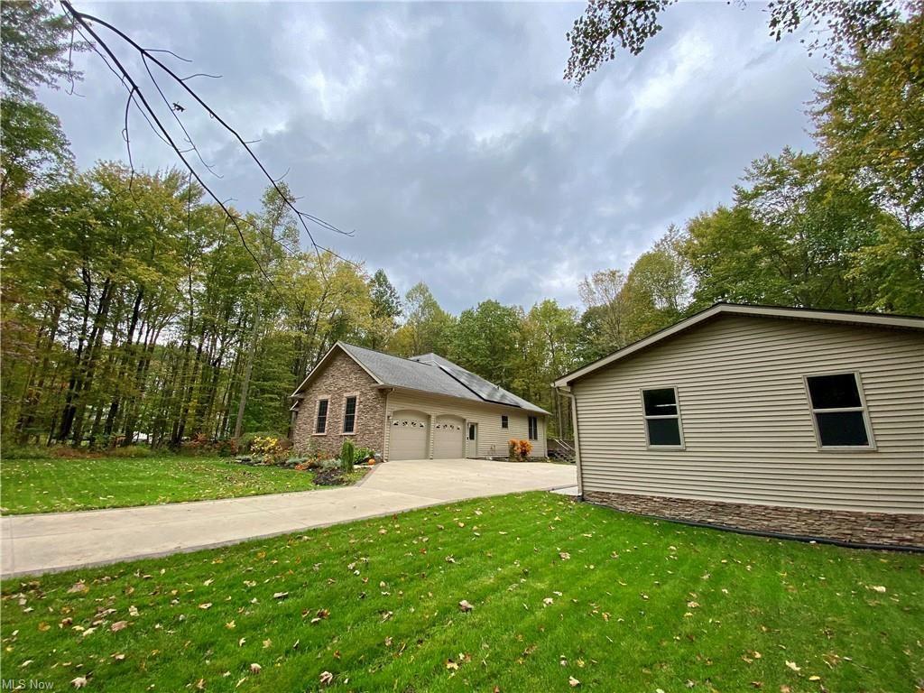 Photo of 5343 Wildwoods Drive, Rock Creek, OH 44084 (MLS # 4327645)