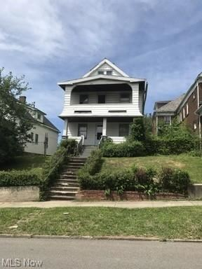 Photo of 10609 Lamontier Avenue, Cleveland, OH 44104 (MLS # 4308698)