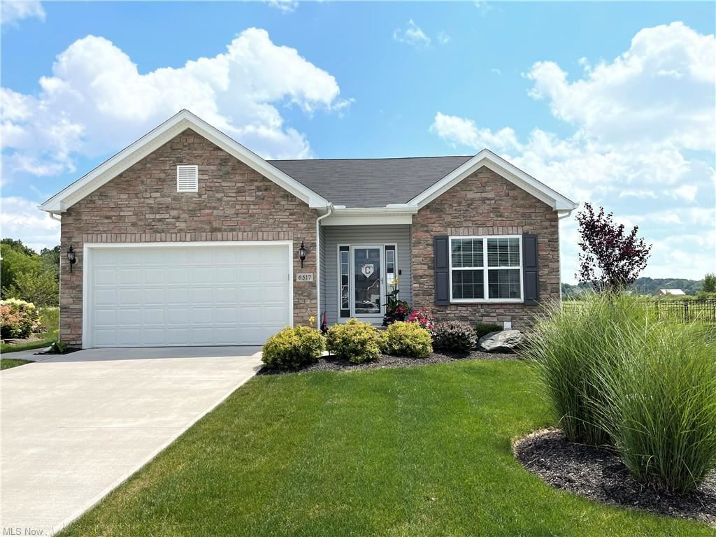 Photo of 6517 Tree Top Place, North Ridgeville, OH 44039 (MLS # 4303838)