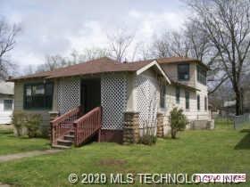 Photo of 627 N Griffin Avenue, Okmulgee, OK 74447 (MLS # 2008751)