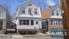 Photo of 53 Cummings Street, Irvington, NJ 07111 (MLS # 21002434)