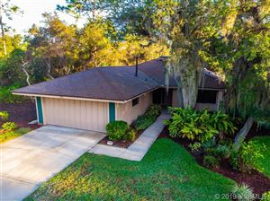 Photo of 699 Saint Andrews Circle, New Smyrna Beach, FL 32168 (MLS # 1054051)