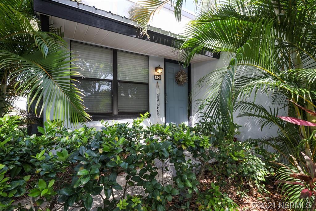 Photo of 42 Jacaranda Cay Court #42, New Smyrna Beach, FL 32169 (MLS # 1066063)