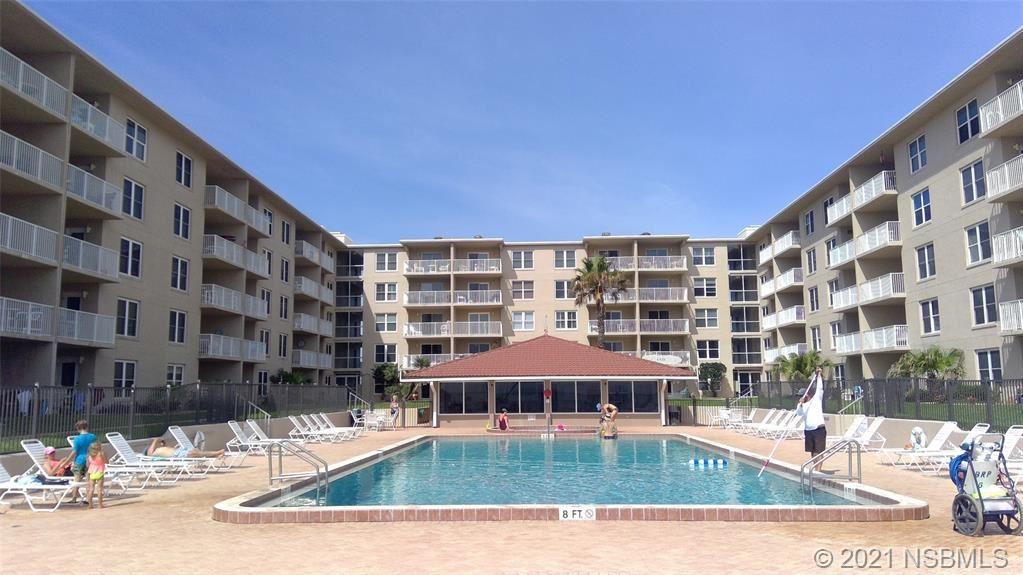 Photo of 4155 S Atlantic Avenue #210, New Smyrna Beach, FL 32169 (MLS # 1064069)
