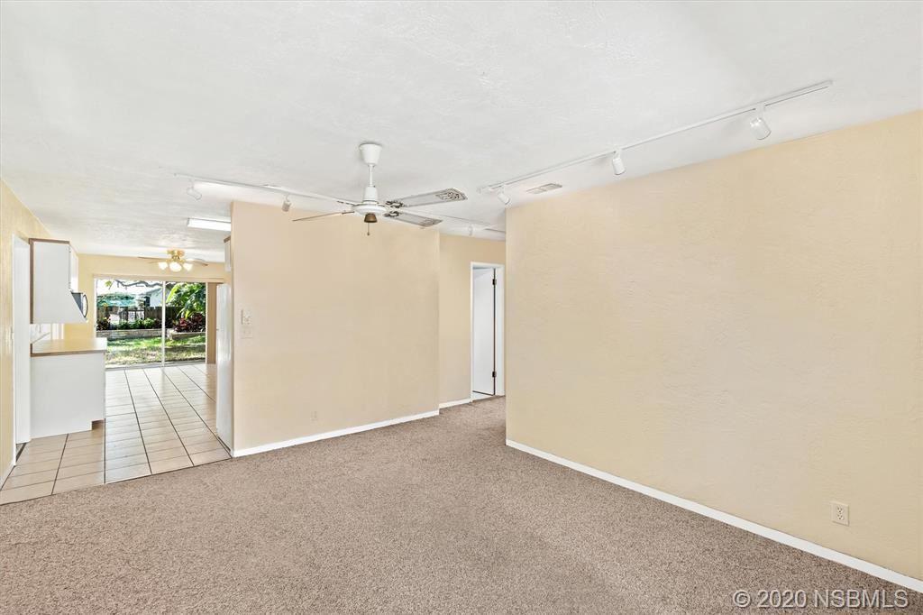 Photo of 819 E 11th Avenue, New Smyrna Beach, FL 32169 (MLS # 1060080)