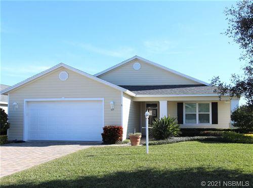 Photo of 435 Eldora Drive, Oak Hill, FL 32759 (MLS # 1062091)