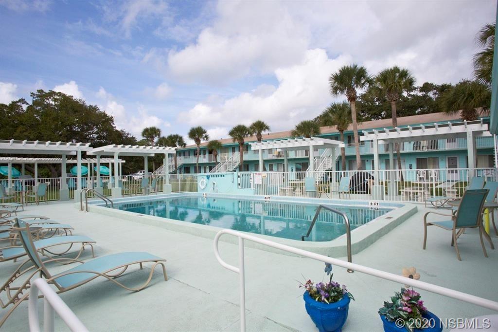 Photo of 541 S Peninsula Avenue S #A06, New Smyrna Beach, FL 32169 (MLS # 1060111)