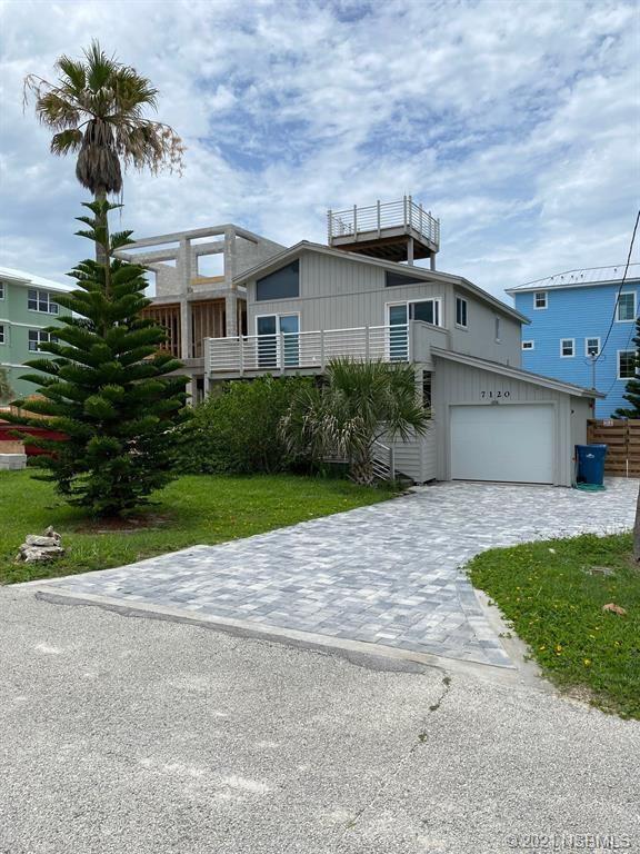 Photo of 7120 S Atlantic Avenue, New Smyrna Beach, FL 32169 (MLS # 1066111)