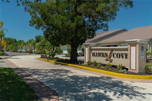 Photo of 2215 Hawks Cove Circle, New Smyrna Beach, FL 32168 (MLS # 1063154)
